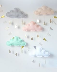 Little clouds made of felt - would look cute as a mobile in a baby nursery