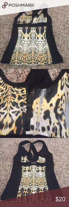 Bebe workout tank Bebe work out tank top. Front zipper and built in sports bra bebe Tops Tank Tops