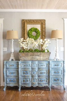 French Provincial dresser with Chalk Paint® by Annie Sloan | Base coat of Aubusson Blue then layered colors of Provence, Duck Egg Blue, French Linen and Paris Gray. Finished with Clear and Dark Chalk Paint® Wax. Incredible project by Edith and Evelyn Vintage.