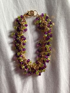 Chunky clear glass purple and light green beaded charm bracelet on gold chain!  Price: £8  Warning: Please keep this bracelet dry at all times! Do not wear it in the shower or continuous water use!