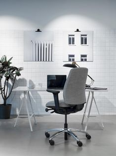 The way we work depends on who we are, what we do and when we do it. But one thing that unites us is the need for wellbeing during long hours by the desk. The new and improved RH Logic office chair is a natural choice for lasting individual comfort. Click to see more workspace inspiration and discover more from Flokk! #flokk #workspaceinspiration #scandinaivandesign #officechair #officegoals Small office space with grey office chair and natural light.