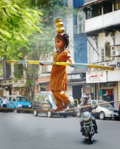 A young tight rope walker in Mumbai, India