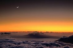 Crescent Moon rises over Lanai Island at sunset