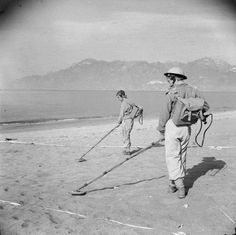 Men of 42nd Field Company, Royal Engineers sweeping a beach near Salerno for mines, 21-23 September 1943.