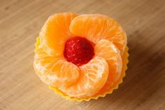 A Fruit Flower! Using a cupcake liner, create a flower with clementine slices and a berry for the center.