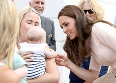 Kate Middleton Photos Photos - Catherine, Duchess of Cambridge greets a young…