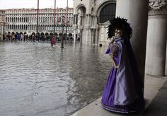 Wouldn't be Venice without a flood: A large part of the essence of the Carnival, colourful costumes and stunning architecture, is on display in this image at Piazza San Marco Carnival 2015, Carnival Of Venice, Europe News, Festivals Around The World, High Tide, Modern Classic, Wigs, Seasons, Celebrities