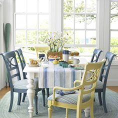 Love the look of the white table with the pale blue chairs but