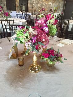 Wedding Flowers. Ceremony Centerpieces. Gold mercury Vases. Gold mercury stands. Pink and Gold. Pink Flowers. Pink Hydrangea. Pink roses. Antique Hydrangea. Seeded Eucalyptus. Tablescape. Table centerpiece. Clustered flowers. Clustered arrangements. Gold and Pink. Bold Pink flowers. Oakleaf Florist.