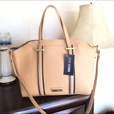 HP 12/1/15 Steve Madden Satchel/Crossbody HPNew with tags... In Camel...Very cute design with zippers. Lots of space..   BUNDLE AND SAVE  Steve Madden Bags