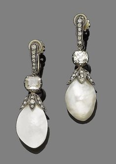 A pair of late 19th century mother-of-pearl and diamond pendent earrings.  Each mother-of-pearl drop capped by rose-cut diamonds and suspended from a cushion-shaped and rose-cut diamond surmount, mounted in silver and gold, diamonds approx. 1.50cts total, screw fittings, length 4.2cm, fitted case by Garrard & Co, 24, Albemarle St., W.