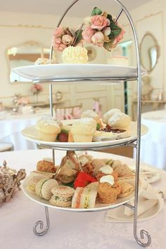 Elegant displays of cakes and sandwiches