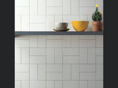 Cosmopolitan white is a small format tile in a size. This glossy tile is suitable for walls in any room. Create a simple look or mix with Cosmpolitan colours for more inspiring layouts! Metro Tiles Kitchen, Metro Tiles Bathroom, White Bathroom Tiles, Bathroom Interior, Kitchen Tile Designs, Grey Kitchen Wall Tiles, Design Bathroom, White Tiles Black Grout, White Subway Tiles