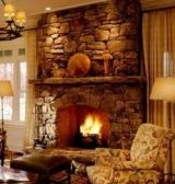 The stone fireplace hearth . few things are as warm and inviting as a crackling wood fire in a cozy stone fireplace! Stone Fireplace Pictures, Stone Fireplace Designs, Stone Fireplace Surround, Stone Mantel, Wood Fireplace Mantel, Wood Mantels, Custom Fireplace, Fireplace Ideas, Open Fireplace