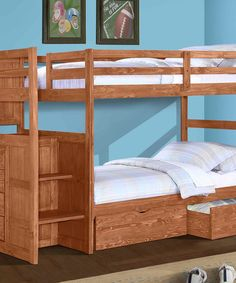 """Double up on the sleeping arrangements in this space-saving bunk bed. Crafted in solid pine with a rich cinnamon finish, it has a built-in four-drawer chest and two pull-out drawers underneath: perfect for a growing family.Includes guardrails, reversible stairway and drawersMatresses not includedFits twin mattresses103"""" W x 63"""" H x 41.75"""" DPineAssembly requiredImported"""