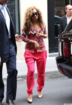 All hail Beyonce, Queen of the Wild Pants! Beyonce was sporting the kind of wild outfit only she could pull off: a hot pink and yellow zigzag print blouse, pointy high heels and hot pink pants.  Don't try this at home!