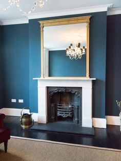 Terrific No Cost large Fireplace Hearth Strategies Finished here in Standard Gilt – a striking complement to the room colour scheme Modern Living Room Colors, Teal Living Rooms, Living Room Color Schemes, Blue Rooms, New Living Room, Home And Living, Living Room Designs, Living Room Decor, Blue Feature Wall Living Room
