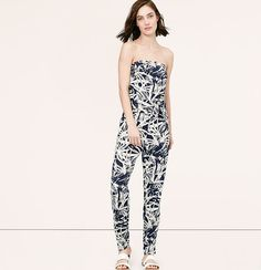 """We're obsessed with the striking silhouette of this palm-printed beauty. Strapless. Removable self belt. Slash pockets. Back welt pockets. 26 1/2"""" inseam."""