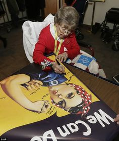 Former Rosie, Frances Reeck signs a Rosie the Riverter poster while visiting Washington, DC on Tuesday