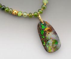 The Faraway Nearby: A teardrop-shaped Australian boulder opal full of vivid…