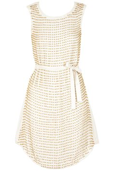 White fully beaded dress available only at Pernia's Pop-Up Shop.