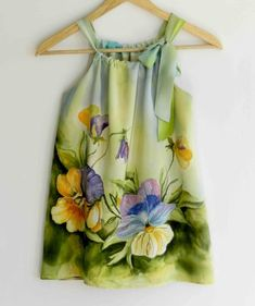 Very beautiful hand painted dress for girls. I have painted this dress on a natural silk crepe-de -chine with pansy flowers and olive green , Hand Painted Dress, Painted Clothes, Painted Silk, Trendy Dresses, Nice Dresses, Silk Dress, New Dress, Little Girl Dresses, Girls Dresses