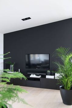 TAILORED TV SOLUTION Love this way of dealing with the fact that a screen is usually a big rectangle on the wall… Living Room Tv, Home And Living, Living Spaces, Home Room Design, Living Room Designs, House Of Turquoise, Dream House Exterior, Black Walls, House Rooms
