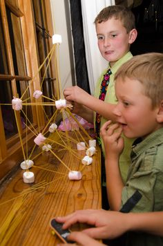 Keeping the kids busy - boys vs girls building marshmallow and spaghetti towers. Kids wedding activity.