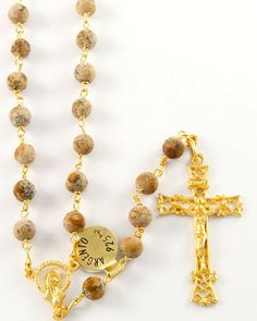 """Gold over Sterling Silver (Vermeil) Genuine Paesina Stone Rosary. Professionally crafted by artisans and imported from Italy. 6mm genuine paesina stone beads. Features gold over sterling vermeil links and Madonna in the Stars centerpiece. The highly detailed gold over sterling silver crucifix is approx. 1.75"""" high. This rosary has an inner length of approx. 26"""", so it may also be worn! Comes in an elegant box. Silver probe: .925%."""