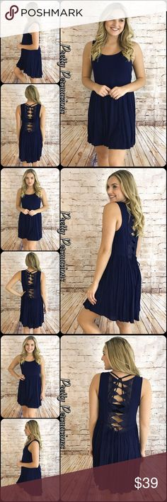 """NWT Navy Crochet Back Sleeveless Baby Doll Dress NWT Navy Crochet Back Sleeveless Baby Doll Dress   Available in S, M, L Measurements taken from a small  Length: 34"""" Bust: 34""""  Rayon  Features  • crochet detailing down center back • ties at waist • sleeveless  • rounded neckline  • soft, breathable, non-sheer material  • relaxed fit w/pull over design  Bundle discounts available  No pp or trades  Item # 1/2JC102290390NBCD crochet lace navy blue dress Pretty Persuasions Dresses"""