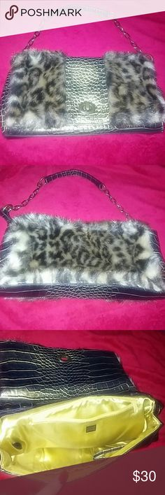 MX faux fur + crocodile skin purse/clutch Beautiful MX faux fur and crocodile skin purse or clutch, the buttons for the shoulder strap can be set to the outside to actually have the strap on or to the inside to hide the strap inside the bag.  Is a beautiful gold color on inside minimal wear in great condition. Bags Clutches & Wristlets