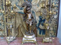 A quality bronze garniture set. Statue signed : Aug.Moreau Sizes statue : 0.85 m total high and candlesticks : 0.90 m high
