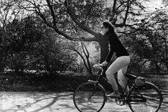 Jackie Kennedy Onassis riding her bicycle!