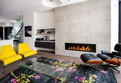 modern #fireplace in a colorful + #minimal living room #design ...