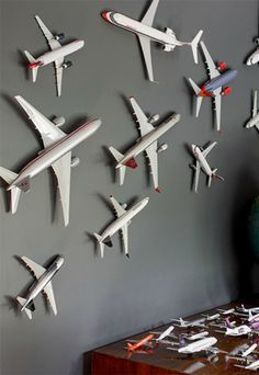 dark grey as a wall color. Makes everything pop, like these mounted toy airplanes + globe.Loving dark grey as a wall color. Makes everything pop, like these mounted toy airplanes + globe. Aviation Decor, Airplane Decor, Baby Bedroom, Kids Bedroom, Boys Airplane Bedroom, Bedroom Themes, Bedroom Ideas, Bedroom Toys, Airplane Nursery