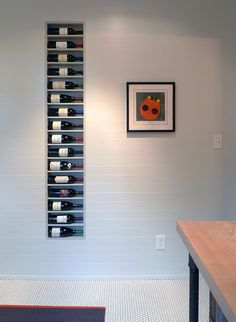 cool recessed wine rack......shelves are built on a 4 degree slope so wine bottles won't roll out....