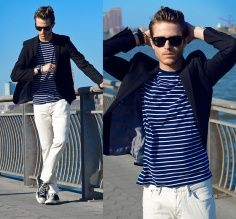 Men's navy and white striped shirt, blue blazer, white denim, converse running shoes, wayfarer sunglasses
