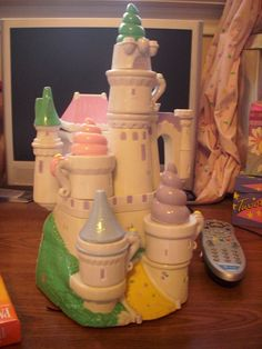 i remember i had one of these, and you could play tea party with it! i wish i still had this! Mine was pink!