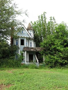 Abandoned Victorian near a go-kart track in Houston, Texas.