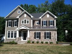 Stone Front Homes nottingham model. house with a partial stone exterior. | elegant