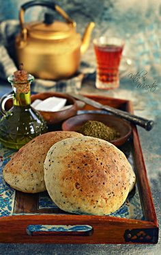 """Ftoot Bread(Palestinian bread)Ftoot Bread is famous since ancient times as an essential breakfast component. It is called """"Ftoot"""", meaning crumbled, in reference to the crumbled white cheese used in it as a main ingredient. This 'boiled"""" white cheese, originally from the city of Nablus, is a staple in Palestinian and Jordanian cuisines, since it is considered one of the most common dairy products used in a wide range of sweets and pastries... Ftoot bread is usually served along with homemade"""