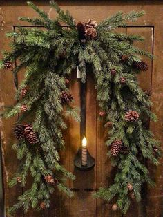 Simple country Christmas door wreath and candle Christmas Swags, Prim Christmas, Country Christmas, Winter Christmas, Christmas Holidays, Simple Christmas, Christmas Carol, Christmas Greenery, Cowboy Christmas