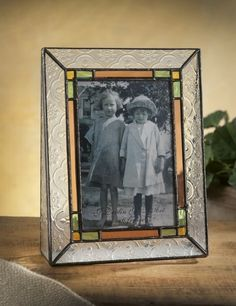 Stained glass picture frames are timeless and classy, yet modern too. I'd love to have a whole collection of these! $27
