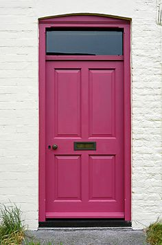 The only thing I could love more than a red door on a white house is a pink door. can I star this as the color I really want? Purple Front Doors, Purple Door, Front Door Colors, Red Door House, House Front, Front Porch, Knock Knock, Pink Home Decor, Windows