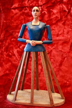 Stunning Old Santos Cage Doll made of Wood with Glass Eyes.