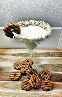 Somoa Cookie Cocktail - 2oz Godiva Chocolate liqueur (we used the White Chocolate version)  2oz Malibu Coconut Rum  1oz Disaronno  1/2 cup shredded, sweetened coconut  3 tablespoons Chocolate syrup  Samoa cookies for garnish