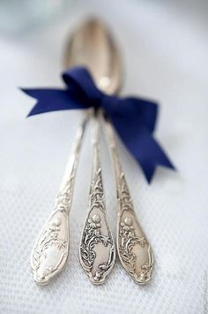 Antique spoons on white cloth tied with blue ribbon...Blueberry Hill Farm