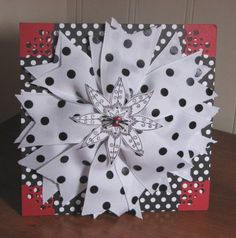 Flower out of ribbon - would be good gift package topper