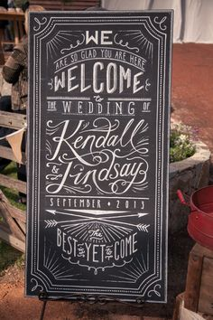 Hand-lettered wedding chalk board