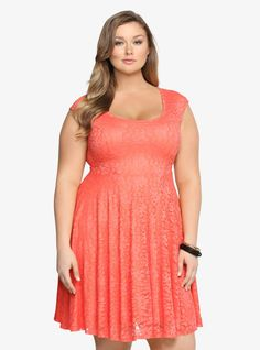 Nothing brightens up your day like a little coral! This lively lace dress has a pretty allover floral design. A circular open back gives this soft, feminine style a sexy touch. Fully lined.
